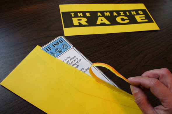 The Amazing Race tear-strip envelopes