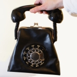 http://www.chicaandjo.com/wp-content/uploads/2012/01/rotary_phone_purse_thumb.jpg