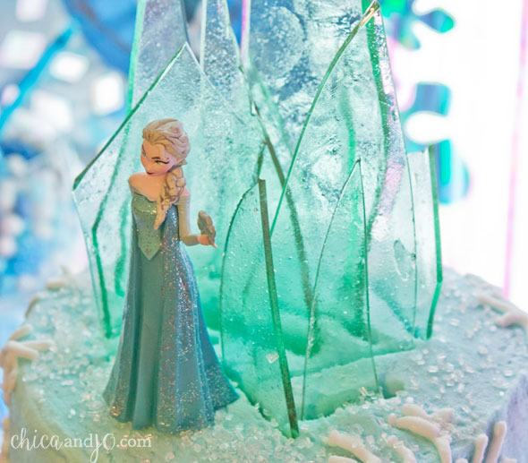 Frozen cake topper with candy ice castle