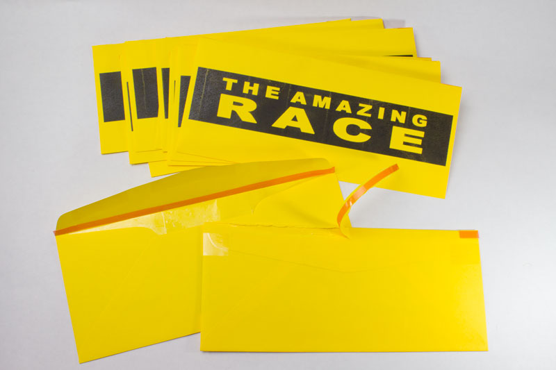 Amazing Race tear-strip envelopes | Chica and Jo