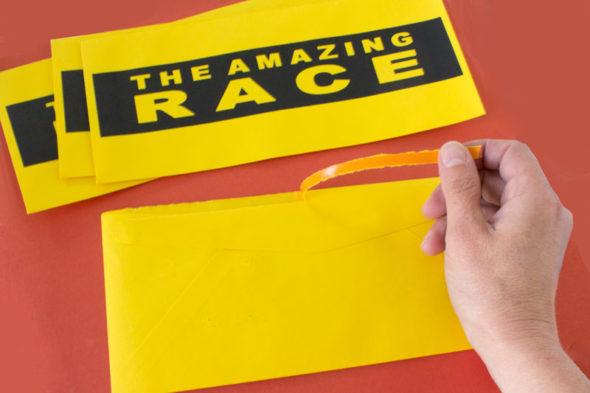 Amazing Race tear-strip envelopes