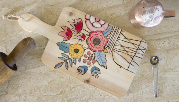 Wood burning a modern floral design on a cutting board Chica and Jo